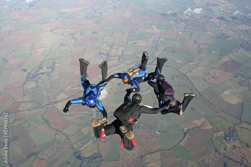 Papiers peints Aerien Four skydivers training