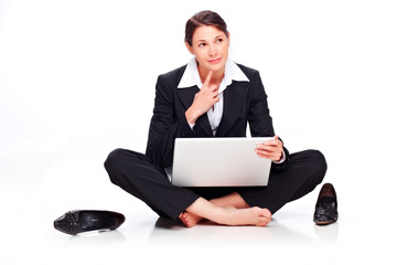 Young business woman sitting on the floor with laptop