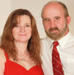 A Middle Aged Married Couple in Red Dress and Red Tie
