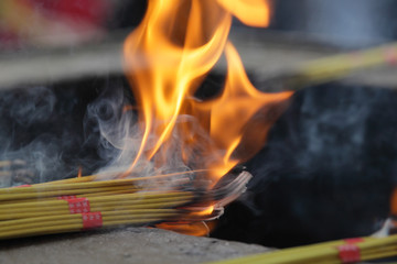 Burning Incense Sticks at Buddhist temple in China