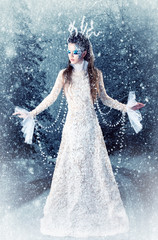 Beautiful brunette in a dress of Snow Queen