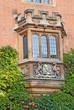 Bay-window with heraldic symbols in Cambridge, UK