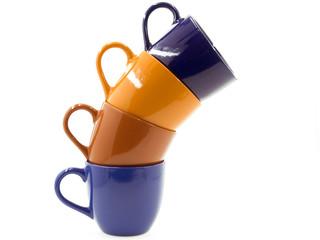 Четыре чашки различных цветов
