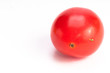 Single small red tomatoe on isolating background