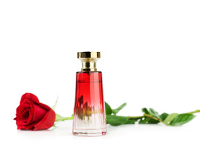 Perfume bottle and red rose
