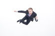 Businessman jumping midair