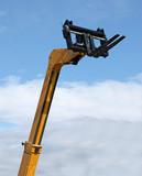 A High Lift Yellow Hydraulic Fork Lift Truck. poster