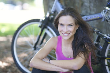 Beautiful Woman Cyclist Rests