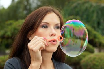 Woman blows bubble