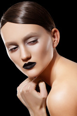 Fashion woman with slicked hairstyle, make-up & black lips