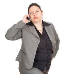 serious overweight, fat businesswoman with mobil phone