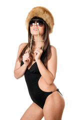woman in black swimsuit biting pearls