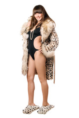 Playful woman wearing leopard coat and house slippers