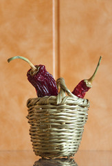 Dried chili peppers in a wicker basket
