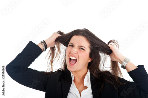 Businesswoman going crazy pulling her hair in frustration