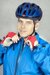 Cyclist Puts On his Helmet 2