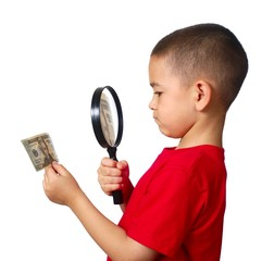 kid examining money, isolated on white