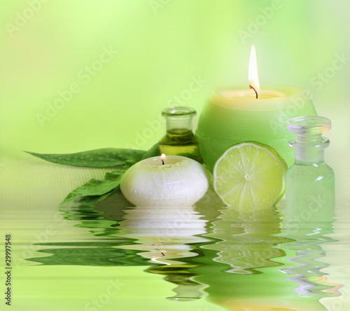 Fresh spa arrangement with candle and essential oil