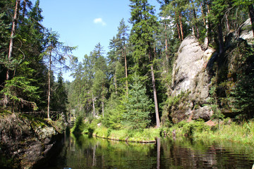 Small lake hidden between sand rocks in Adrspach, Czech Republic