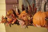 Halloween pumpkin decorations in a window sill poster
