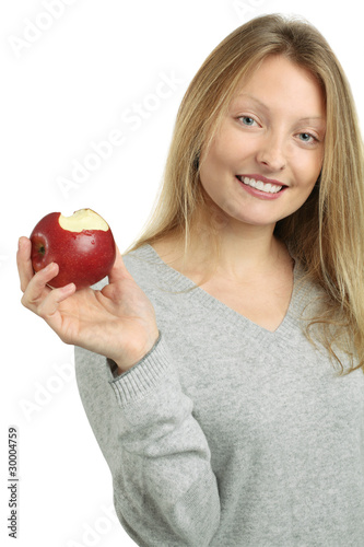 Beautiful blond eating an apple