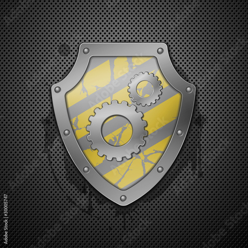 Metallic shield with gears on a white background.