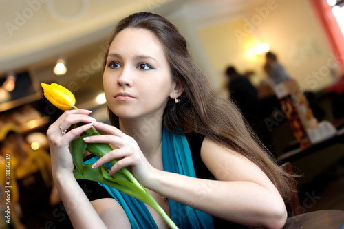 Girl with yellow tulip