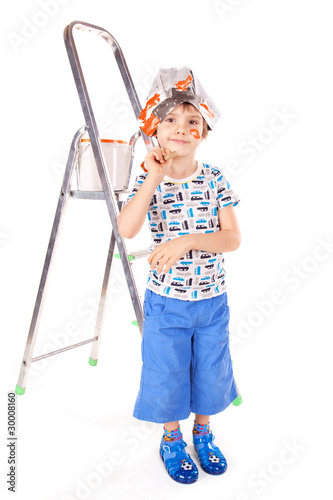Little boy with paint brushes
