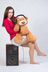 Girl with toy and headphones