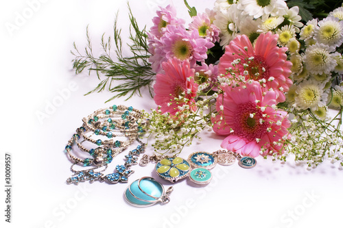 Flowers and jewelry on white background