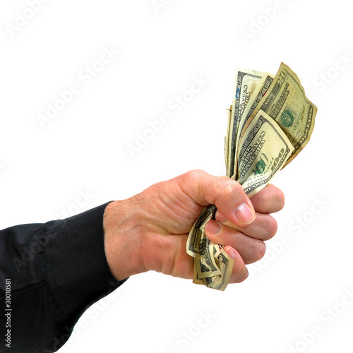 Hand grasping hold of money