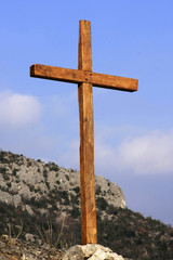 solitary cross on hilltop