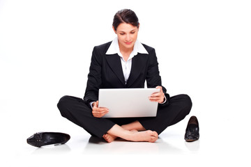 business woman reading e-mail on laptop