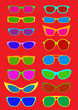 Glasses and Sunglasses on red background