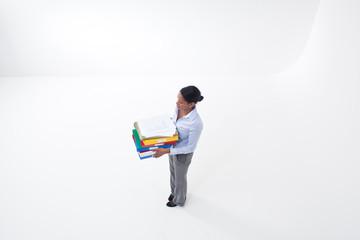 Standing businesswoman holding file folders