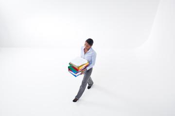 Businesswoman walking with file folders