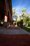 Green garden and the Riad in Ouarzazate poster