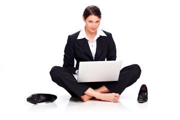 Young business woman writing e-mail