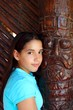 Latin mexican teen girl smile indian wood totem