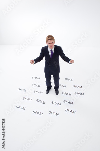 Angry businessman surrounded by spam