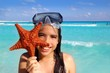latin tourist girl holding starfish tropical beach
