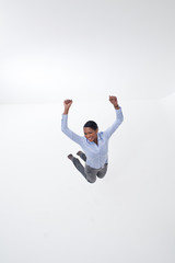 Enthusiastic businesswoman jumping midair