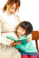 Mother and child read picture book
