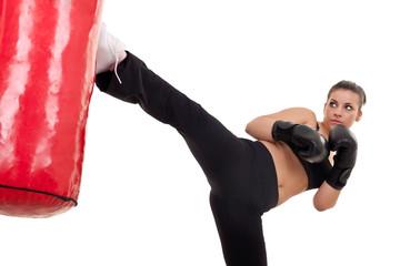 woman kick a punching bag