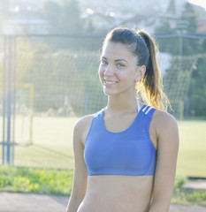 happy young woman on athletic race track