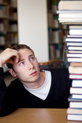 Stressed Student Looks At Book Pile