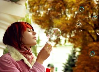 A girl is in an autumn park