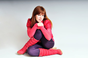redheaded sitiing girl