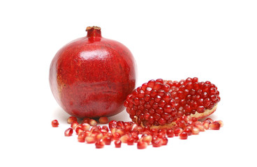 Ripe pomegranate on a white background