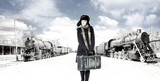 A young woman walkin on an old train station background poster